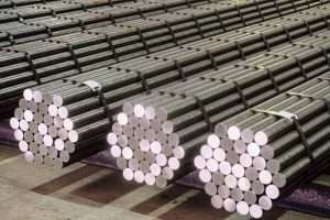 Round steel section rolling profile in stacked. Warehouse of metal products.